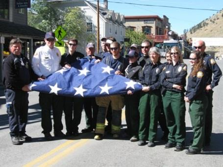 Personnel Holding American Flag